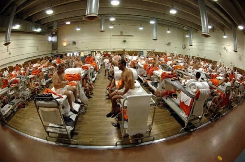 FILE -  In this undated file photo released by the California Department of Corrections, inmates sit in crowded conditions at the California Institute for Men in Chino, Calif. The U.S. Supreme Court on Friday, Aug. 2, 2013 paved the way for the early release of nearly 10,000 prisoners by year's end