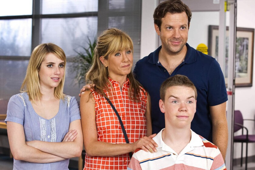 "Emma Roberts, left, Jennifer Aniston, Jason Sudeikis and Will Poulter, front, in ""We're the Millers."" Aniston, Roberts and Poulter won the MTV Movie Award for best kiss on Sunday night."
