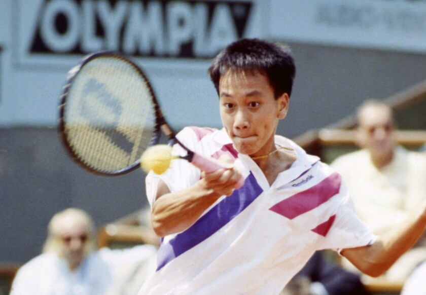 FILE - In this June 9, 1989, file photo, Michael Chang makes a return during his match against Ivan Lendl in the men's singles final at the French Open tennis championships in Paris. Chang would go on to become the youngest male champion at any Slam, beating Lendl 4-6, 4-6, 6-3, 6-3, 6-3. (AP Photo/File)