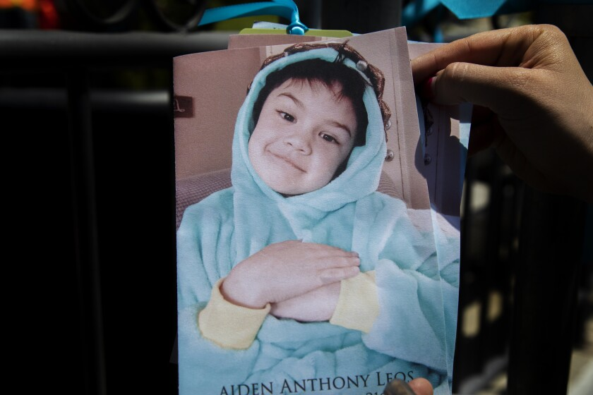 A photo of 6-year-old Aiden Love covers his funeral program.