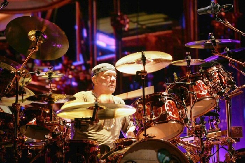 Neil Peart often plays three-hour shows on tour with Rush. A fit lifestyle keeps him going.