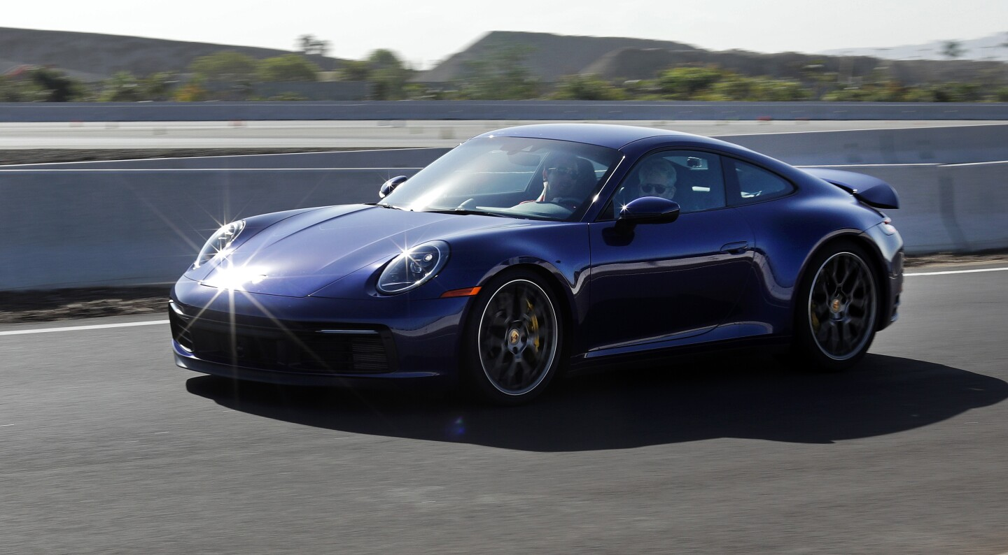 CARSON, CA -- NOVEMBER 26, 2019: The 2020 Porsche 911 Carrera 4S is powered by a 3-liter, 6-cylinder, twin-turbo engine that makes 443 horsepower and 390 pound-feet of torque. The 8-speed automatic will take the car up to a claimed top speed of 190 mph for the hard top and 188 mph for the cabriolet. The MSRP starts at $120,600 for the hard top. (Myung J. Chun / Los Angeles Times)