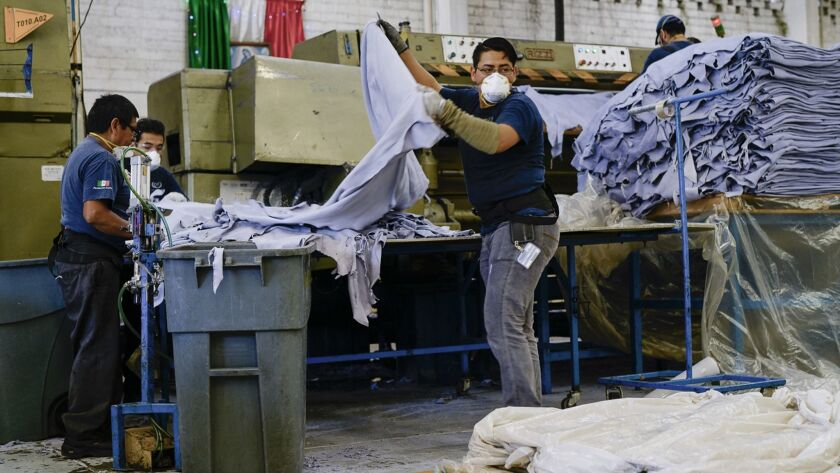 A worker processes hides in a leather tannery in Guanajuato, Mexico. Surging demand for auto upholst