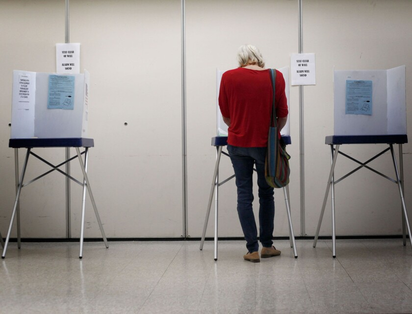 A voter casts her primary ballot in San Luis Obispo on June 3.