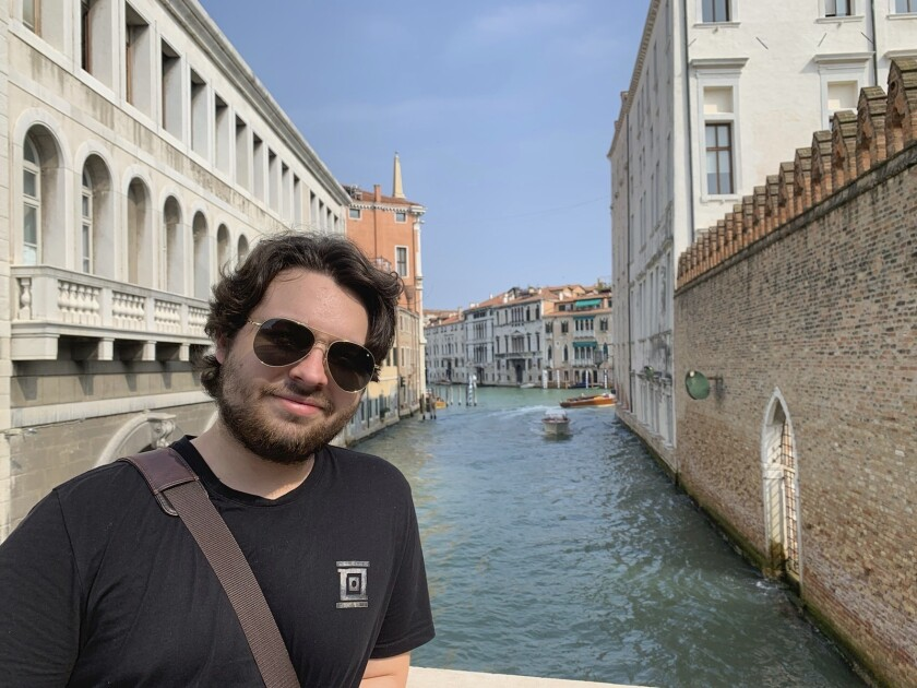 This 2019 photo shows Duncan Lemp in Venice, Italy. Lemp was asleep in his bedroom when police opened fire from outside his house, killing him and wounding his girlfriend, an attorney for the 21-year-old man's family said Friday, March 13, 2020. (Mercedes Lemp via AP)