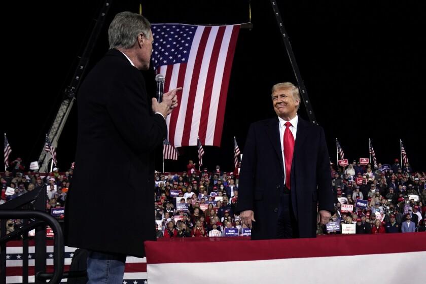 Sen. David Perdue and President Trump onstage at a campaign rally in Valdosta, Ga.