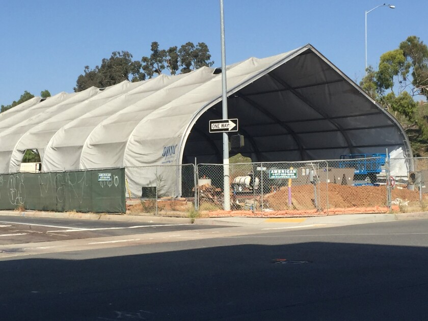 A large tented structure that will serve as a temporary shelter for 150 homeless people is under construction at 17th Street and Imperial Avenue in downtown San Diego and is expected to open by the end of the year. The San Diego City Council on Monday accepted a plan that has a goal of cutting the number of homeless people on the street in half within three years.