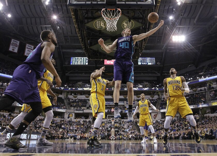 Charlotte Hornets' Cody Zeller (40) grabs a rebound against Indiana Pacers' George Hill (3) during the second half of an NBA basketball game Wednesday, Feb. 10, 2016, in Indianapolis. Charlotte won 117-95. (AP Photo/Darron Cummings)