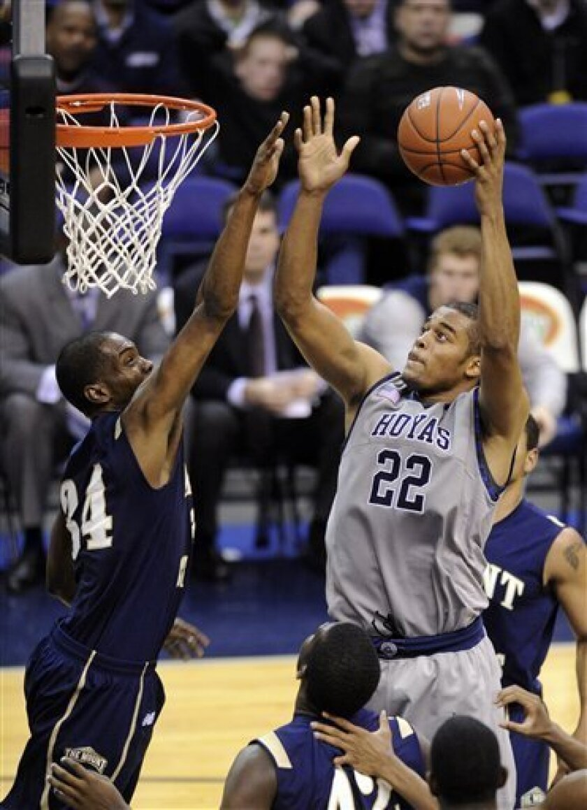 Georgetown's Julian Vaughn (22) goes to the basket against Mount St. Mary's Tayvon Jackson (34) during the second half of an NCAA college basketball game, Monday, Nov. 30, 2009, in Washington. Georgetown won 83-62.(AP Photo/Nick Wass)