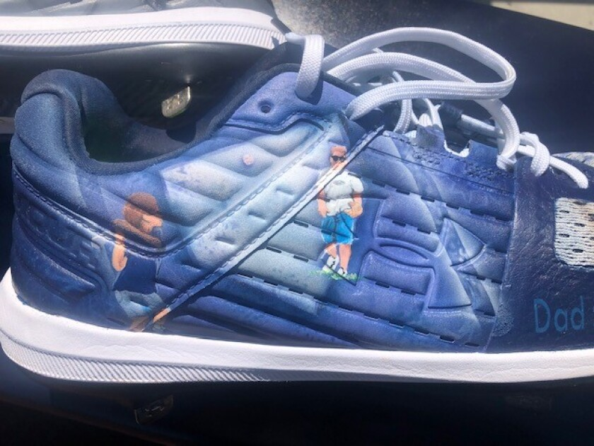 An illustration on Eric Lauer's cleats depicts a picture taken when he was a boy.