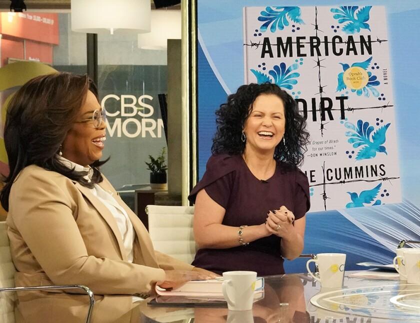 Oprah Winfrey, left, with author Jeanine Cummins