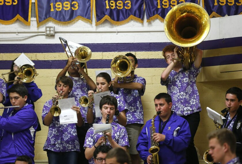 St. Augustine's pep band, frequently clad in loud shirts, preform during a break in the action.