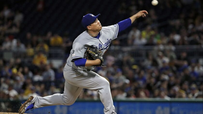 Dodgers starting pitcher Hyun-Jin Ryu delivers in the sixth inning against the Pittsburgh Pirates in Pittsburgh on Saturday.
