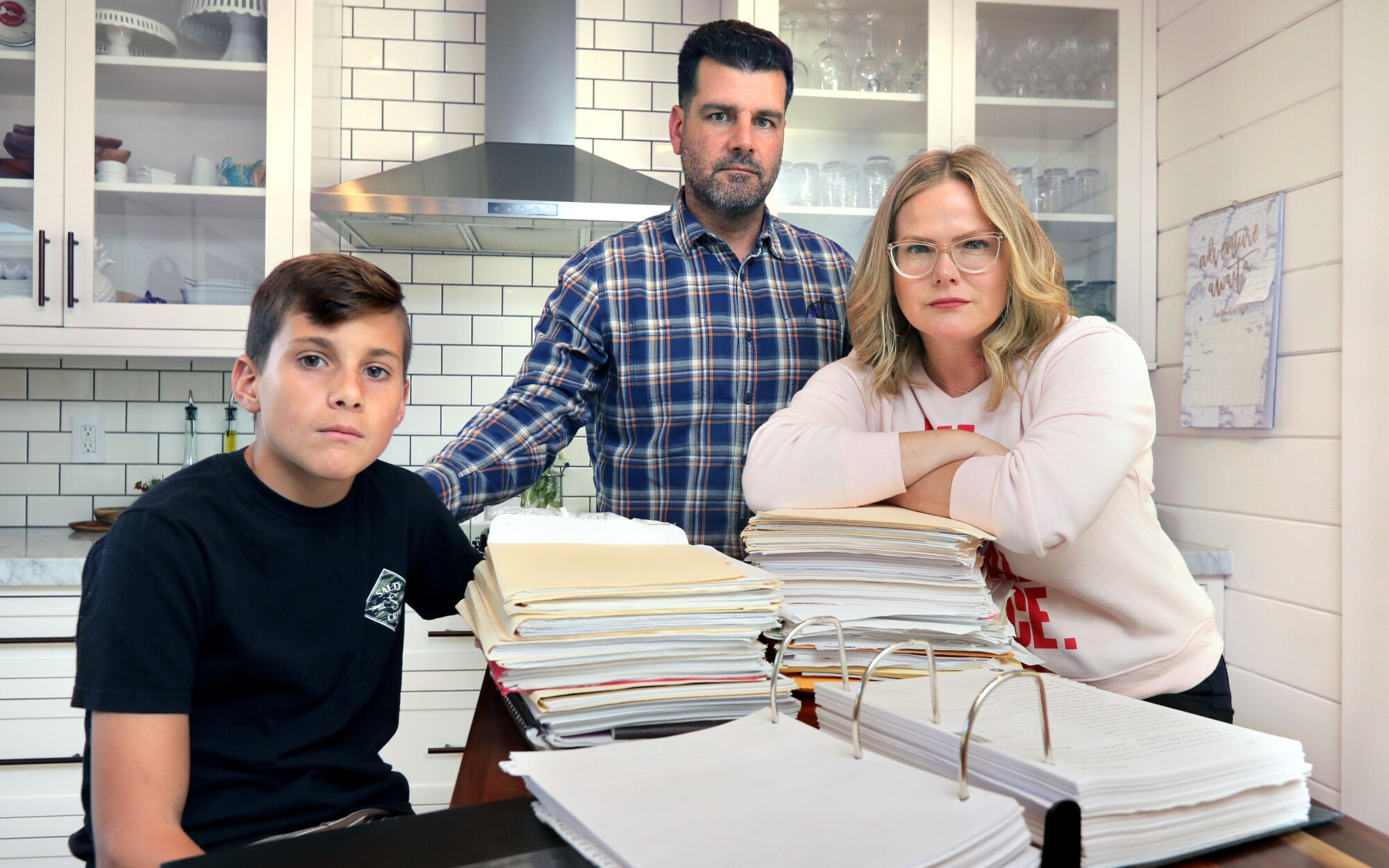 12 year old Diego Lazaro and his parents Oscar and Melissa Lazaro with all of the paper work they've accumulated in their years long effort to get the education they feel Diego deserves with his dyslexia.