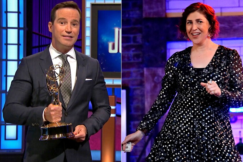 A man holding an Emmy, left, and a woman in a polka-dot dress