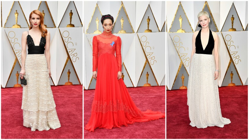 "Emma Roberts in a 12-year-old Armani Privé dress, left, Ruth Negga goes ""pagan goddess"" in custom Valentino, center, and Michelle Williams mines Old Hollywood glamour in Louis Vuitton, right."