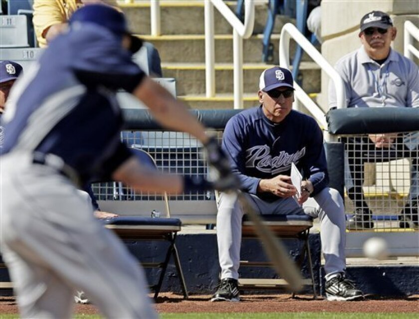 San Diego Padres manager Bud Black watches Travis Buck bat during an exhibition spring training baseball game against the Milwaukee Brewers, Monday, Feb. 25, 2013, in Phoenix. (AP Photo/Morry Gash)