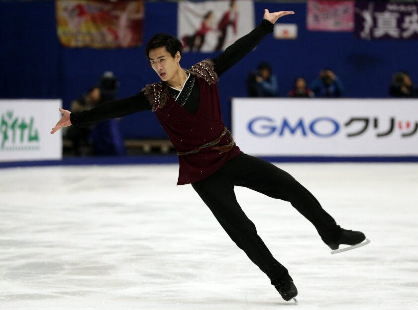 China's Yan Han competes in the Mens Free Skating program during the ISU Grand Prix of Figure Skating at the Capital Gymnasium in Beijing, China, Saturday, Nov. 7, 2015. (AP Photo/Mark Schiefelbein)