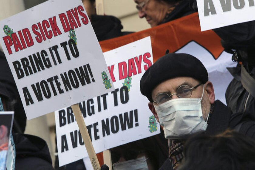 Activists rally in January at New York's City Hall for paid sick leave.