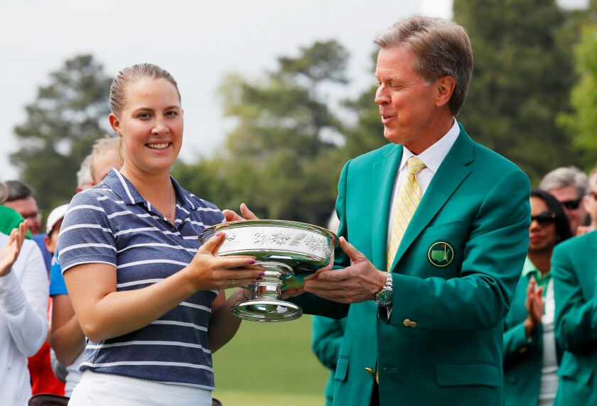 Jennifer Kupcho of the United States celebrates with Chairman of Augusta National Golf Club and the Masters Tournament Fred Ridley and the trophy after winning the Augusta National Women's Amateur at Augusta National Golf Club on April 06, 2019 in Augusta, Georgia