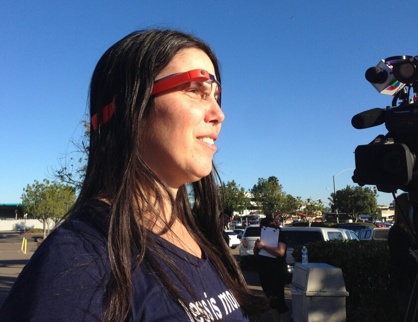 Charges against a motorist who was ticketed for wearing Google Glass while driving were dismissed in San Diego County traffic court on Thursday. Cecelia Abadie wears the high-tech glasses while addressing the media.