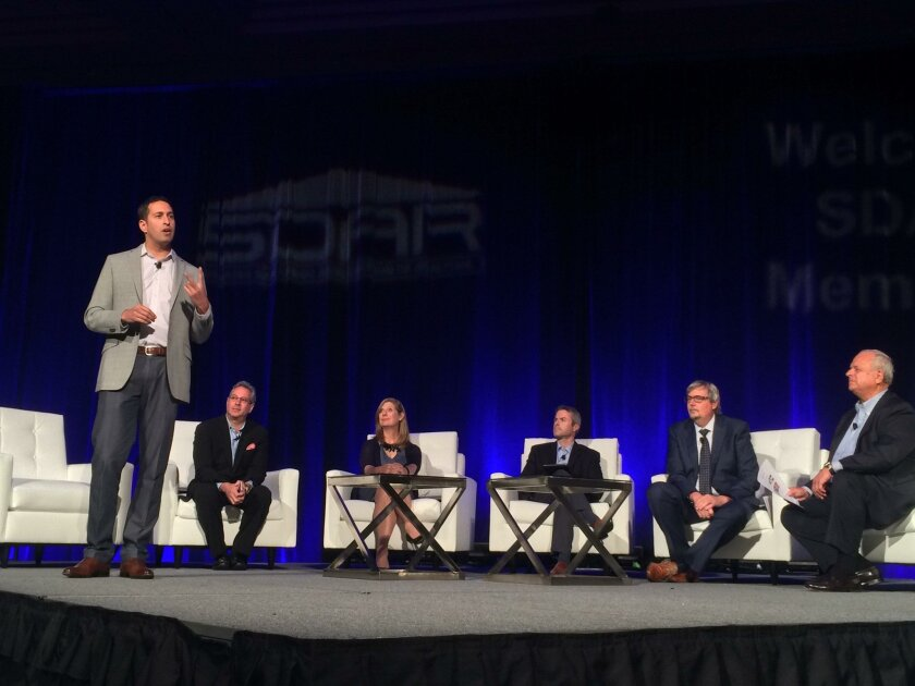 Adam Wiener, chief growth officer at Redfin, tells real estate agents at SDAR Expo 2016 at the San Diego Convention Center, they need to make better websites. Left to right: Victor Lund of Wav Group; Suzanne Mueller, senior vice president of industry relations of Move Inc./Realtor.com; David Mele,