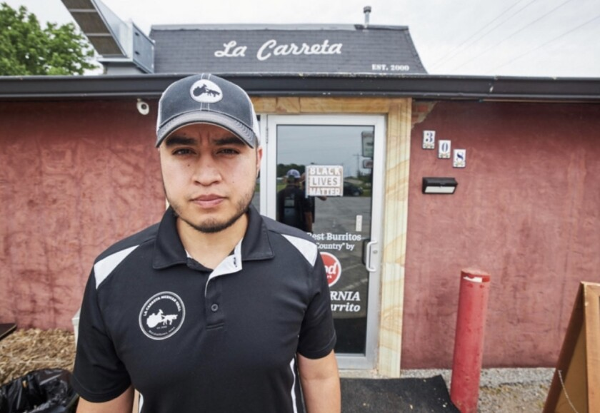 Alfonso Medina of La Carreta Mexican Grill in Marshalltown, Iowa, stands in front of his restaurant.