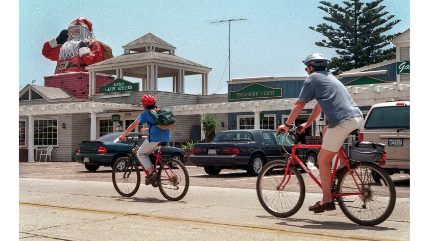 May 25, 1999: The towering Kris Kringle on Santa Clause Lane is visible from the 101 Freewau near Ca