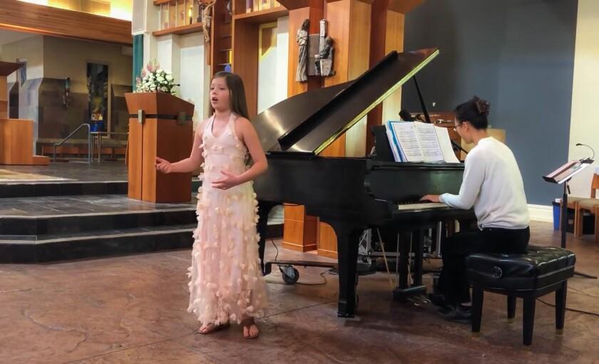 Ksenia Varela recording a song