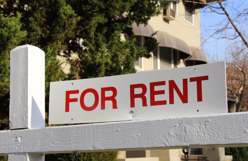 For rent California real estate sign and house home