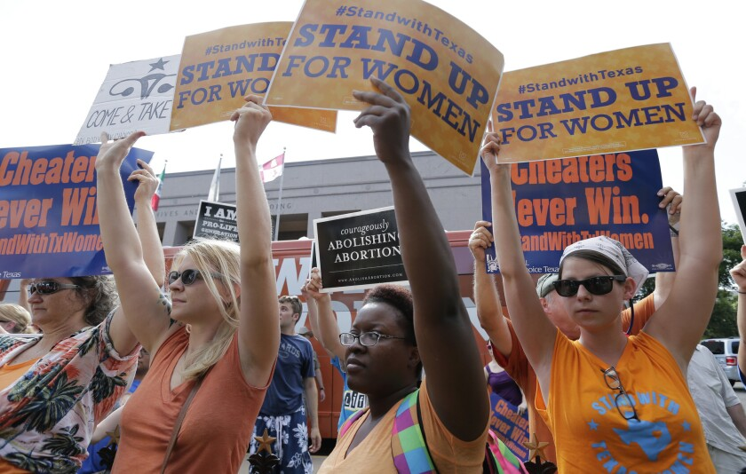 Opponents and supporters of an abortion bill demonstrate at the state Capitol in Austin, Texas, in 2013.