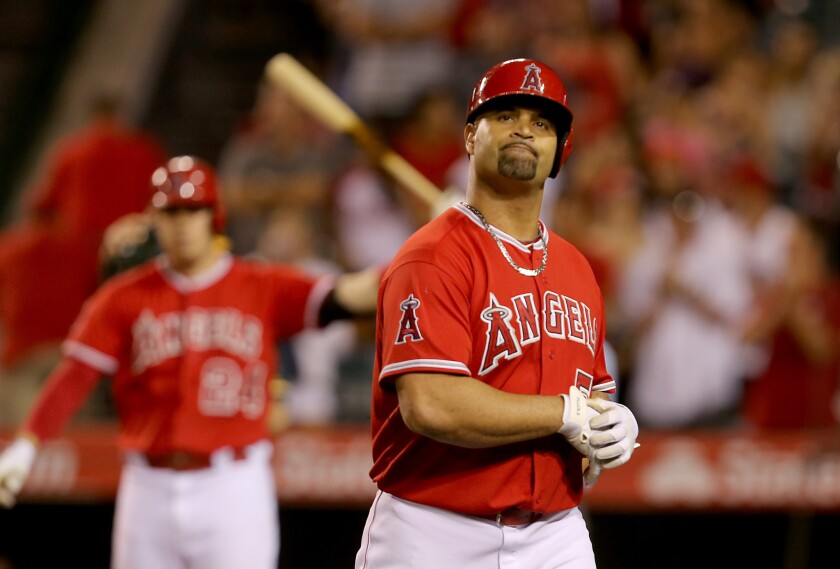 Albert Pujols reacts after flying out and stranding the tying run in the ninth inning against the Athletics on Sept. 30.