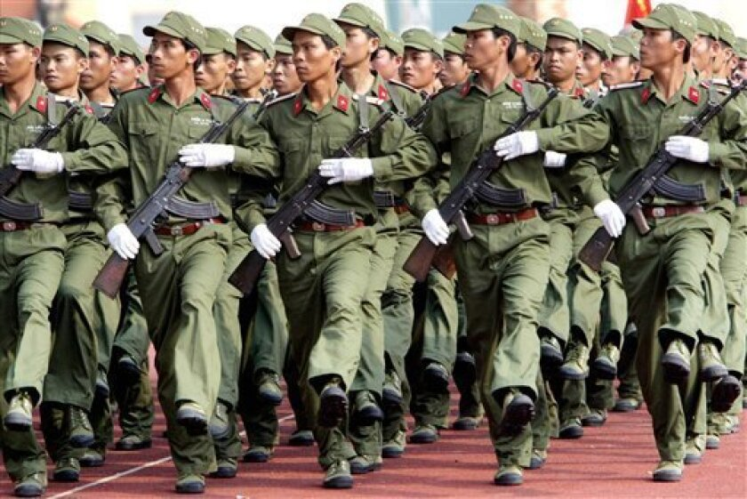 FILE - In this March 29, 2005 file photo, Vietnamese soldiers march through Chi Lang stadium in Danang, Vietnam, during the 30th anniversary of the Communist troops' victory over U.S. military in Danang. According to a state-controlled newspaper report on Tuesday, Feb. 26, 2013, Vietnam will begin participating in United Nation's peacekeeping operations from early next year, a further sign that the Southeast Asian nation wants to assume a bigger role in international affairs. (AP Photo/Richard Vogel, File)