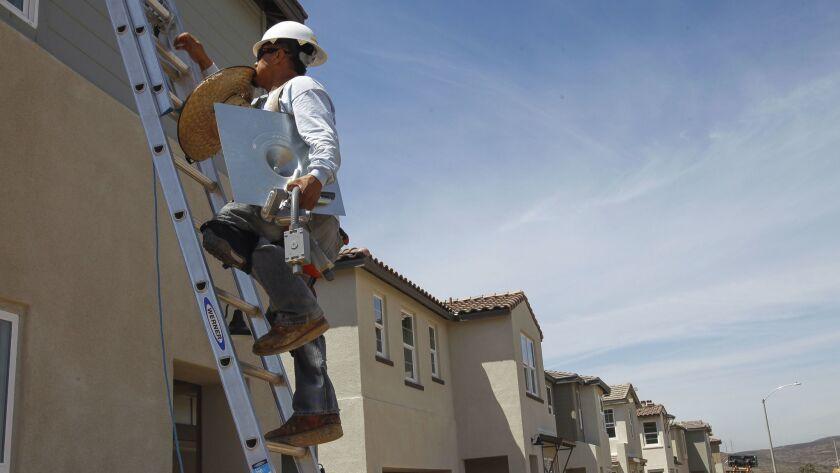 SANTEE, May 8, 2018 | Juan Ortega, a solar panel installer for California Premier Solar Construction