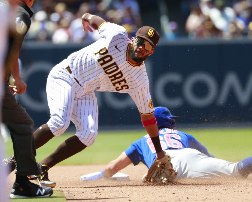 Padres shortstop Fernando Tatis Jr. tags out the Chicago Cubs' Rafael Ortega trying to steal