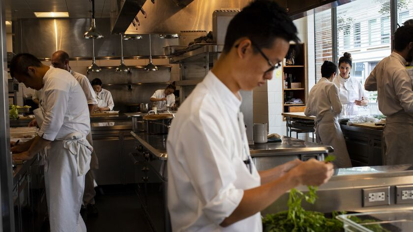 SAN FRANCISCO, CA - SEPTEMBER 12, 2018: Sioux chefs prep for dinner service at Benu, which is consid