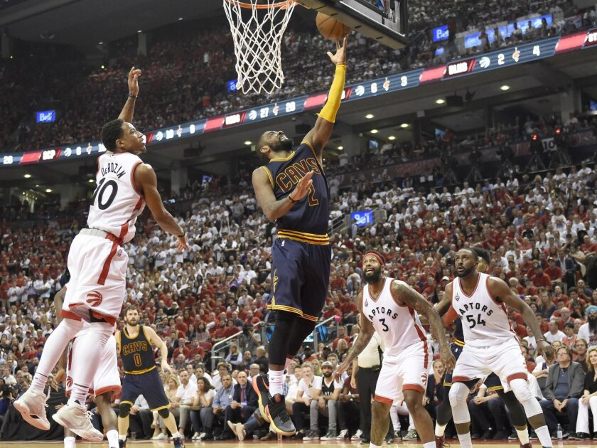 Cleveland Cavaliers guard Kyrie Irving releases a lay-up as Toronto Raptors guard DeMar DeRozan (10) defends during the second half of Game 6 of the NBA basketball Eastern Conference finals, Friday, May 27, 2016, in Toronto. (Frank Gunn/The Canadian Press via AP)