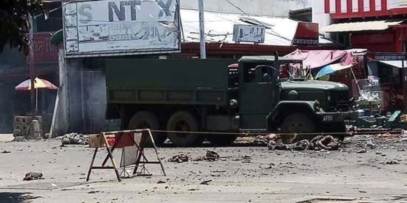 Military truck at an area where a bomb exploded in Jolo, Philippines on Monday