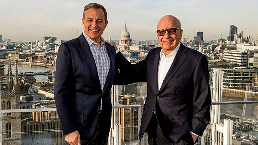 Walt Disney Chief Executive Bob Iger, left, and Fox owner Rupert Murdoch at an undisclosed location. Murdoch and his sons got a big pay bump in fiscal 2018 after orchestrating the sale of much of 21st Century Fox to Walt Disney Co.