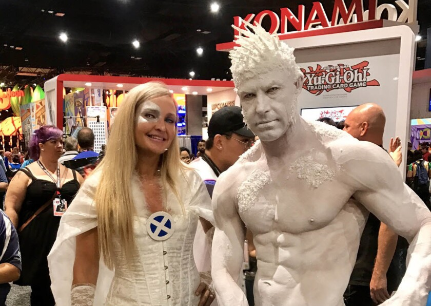 Kristen Hatcher (left) and Todd Schmidt dressed as Emma Frost and Iceman during Day 1 of the 2017 Comic-Con. (Chloe Salsameda)