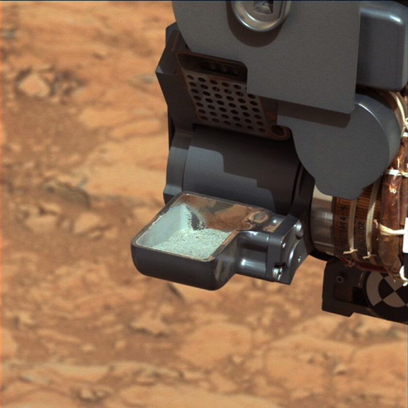 NASA rover Curiosity scoops up first Martian rock sample