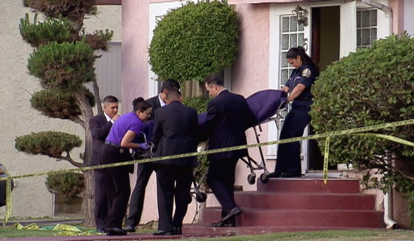 Coroner's officials remove the body of April Jace from her Hyde Park home Tuesday morning. Her husband, actor Michael Jace, was taken into custody at the scene and subsequently booked on suspicion of murder.