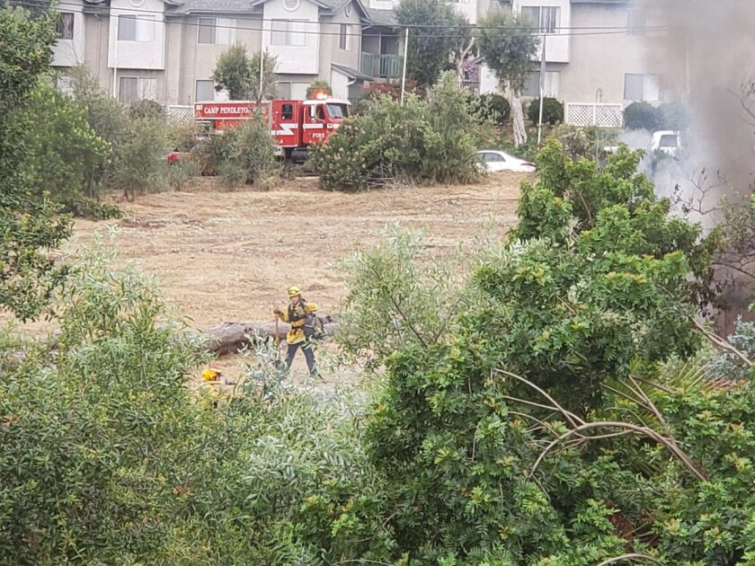 Firefighters extinguished a small brush fire in Fallbrook early Tuesday morning.