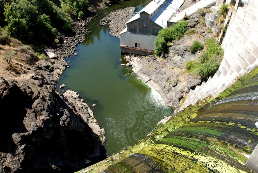 Water trickles over Copco 1 Dam on the Klamath River.