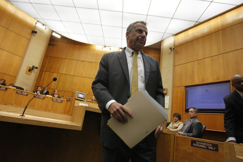 Bob Filner leaves the City Council chambers Friday, Aug. 23, 2013, after he agreed to resign as San Diego mayor.