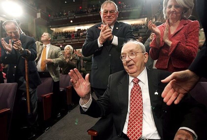 Former Sen. Jesse Helms acknowledges the crowd after being after being saluted by President Bush during an event in Raleigh, N.C.