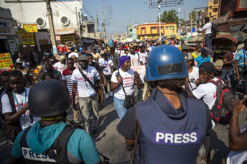 Local journalists take part in a march to protest police brutality towards journalists, in Port-au-Prince, Haiti, Thursday, Jan. 28, 2021. (AP Photo/Dieu Nalio Chery)