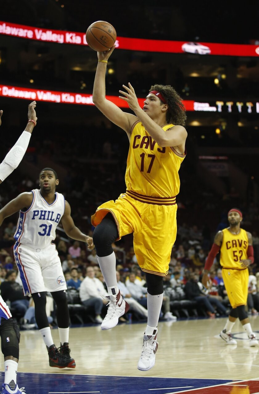 FILe - In this Oct. 8, 2015, file photo, Cleveland Cavaliers' Anderson Varejao shoots during an NBA preseason basketball game against the Philadelphia 76ers, in Philadelphia. Two people with knowledge of the deal say the Cavaliers have acquired forward Channing Frye from the Orlando Magic in a trad