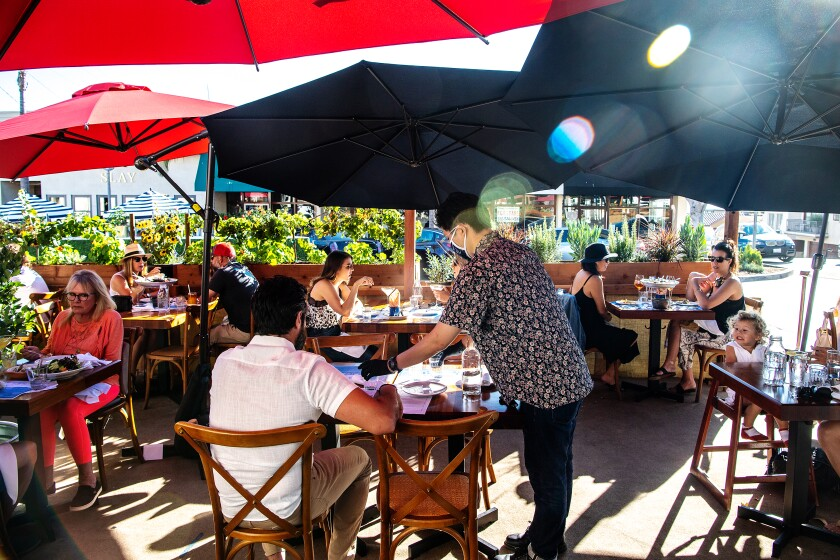 Diners eat outside at Fishing With Dynamite in Manhattan Beach.