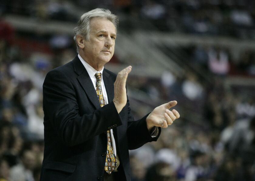 Paul Westphal coaches the Sacramento Kings against the Detroit Pistons.